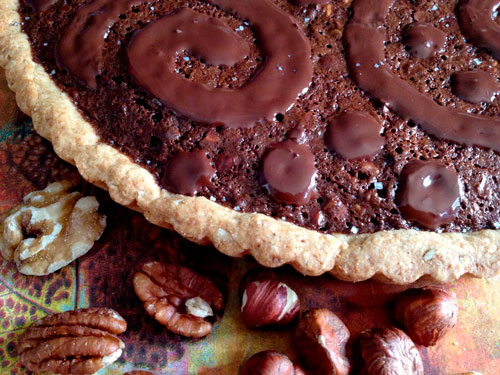 Chocolate Brownie Triple Nut Pie with nuts on side